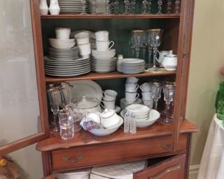 cabinet full or porcelain and glass