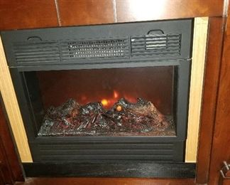 Heat Surge Electric FireplaceADL-2000M-X inside a Amish Made Mantle.