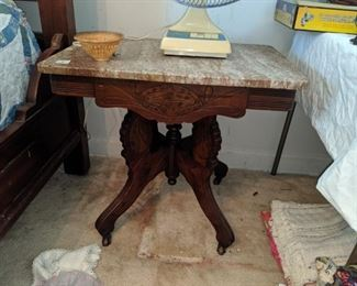 one of several marble top tables