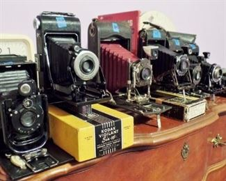 Several early folding cameras
