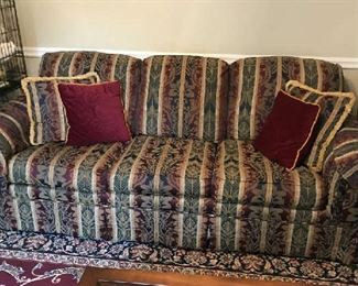 Nice clean upholstered sofa; and there is a matching love seat