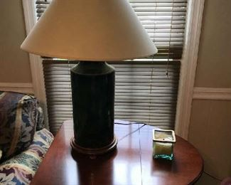 This is a beautiful side table that folds on each side, or out for a round table.  The lamp is also nice - its base is green and nice shade.