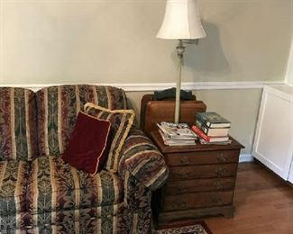 Four drawer end table; there are lots of books here for the mystery reader