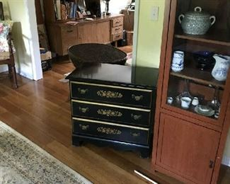 This is one of two maple colored cabinets, a nice Hitchcock chest, and there are two Hitchcock chairs in the home.