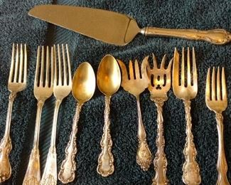 sterling server, forks, spoons