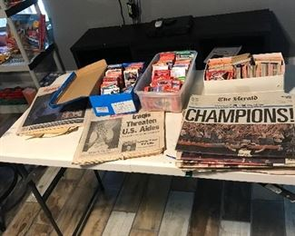 Baseball cards and newspapers