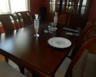 Solid wood table, chairs, china cabinet.. Leaves and table pads  included.