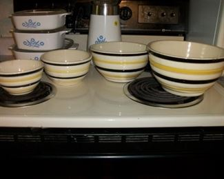 Nesting bowls & Pyrex w/blue flowers in the back