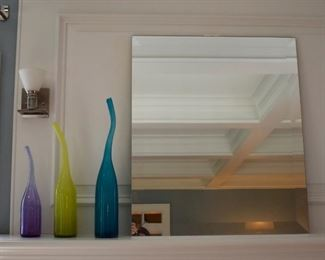 Glass bottles and mirror with beveled edge
