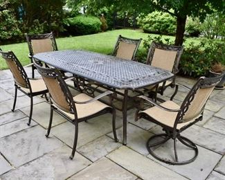 Cast aluminum patio table with 6 chairs
