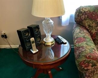 Two matching round end tables