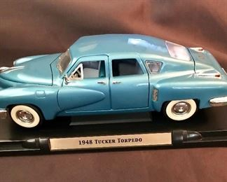 """Die cast 1/18 scale """"1948 Tucker Torpedo"""" car. Has moving parts, 11 1/2"""" long."""