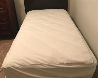 Like new twin bed with box springs and mattress.