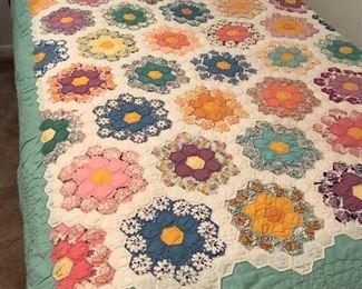 Antique hand sewn quilt, flower garden