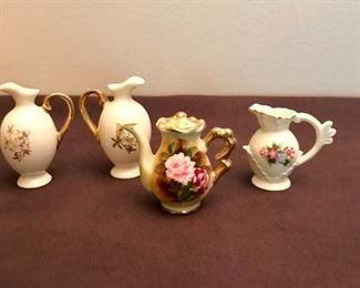 """Enesco"" mini teapot with salt & pepper urns, and a mini handled pitcher."