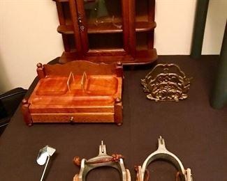 Small curio cabinet, wooden dresser box, brass letter holder, spurs.