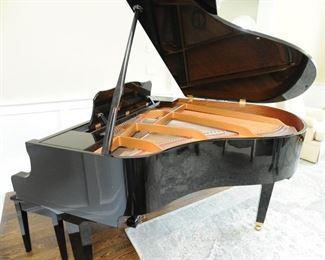 Yamaha 2002 GA1 baby grand piano: Serial number J2004908. Polished ebony finish.