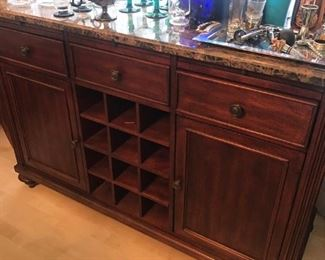 Marble top bar cabinet with wine bottle storage