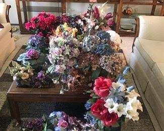 Assorted dried and faux floral arrangements