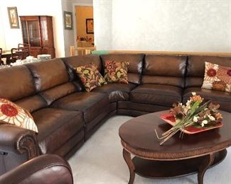Leather sectional with reclining ends