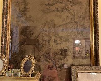 Framed tapestry.