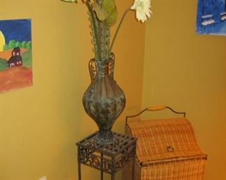 Wicker hamper, plant stand with floral arrangement, unframed art