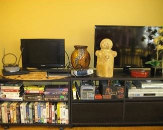 TV stands, TVs, VHS tapes, VCR player