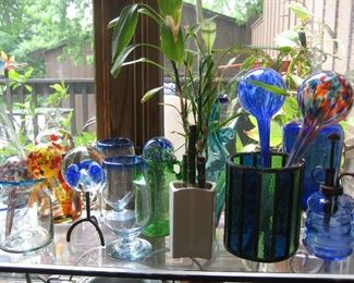 Glass containers and self watering globes