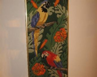 Framed needlework with parrots