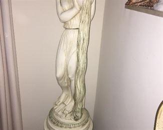 Tall vintage statue on base