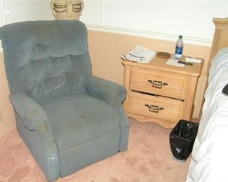 recliner and floor lamp behind nightstand is part of bedroom suite