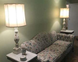 Vintage pair of white and gold trim porcelain base lamps, upholstered sofa with  pair of antique marble top tables