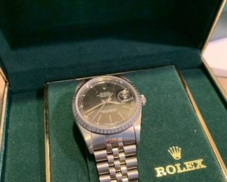 Men's Rolex watch complete with paper work and all packaging.