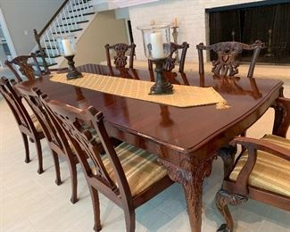 Exceptional dining room set with solid wood carved chairs from England.