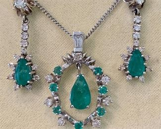 Elegant emerald and diamond demiparure.