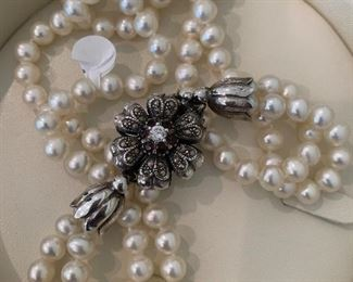 Lustrous pearls with a sterling silver and marcasite blossom clasp.
