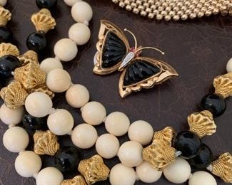 14K and 18K Gold and Onyx.