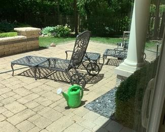 Outdoor patio set includes a table and chairs