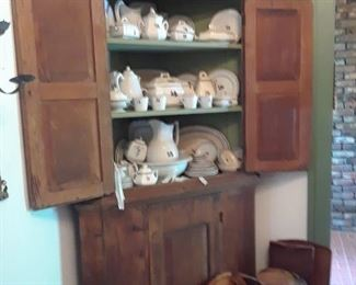 Large primitive corner cabinet in original condition with collection of Alfred Meakin tea leaf dinnerware, also some early ironstone pieces with fruit finials
