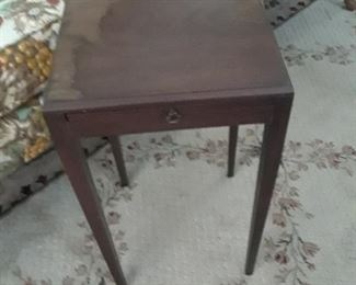 Small side table with pull out tray on side