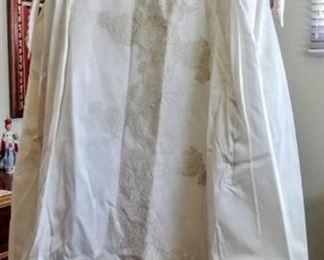 beautiful vintage wedding dress--lace, buttons, train, etc.