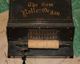 THE GEM ROLLER ORGAN WITH SEVERAL PLAYER ROLLS