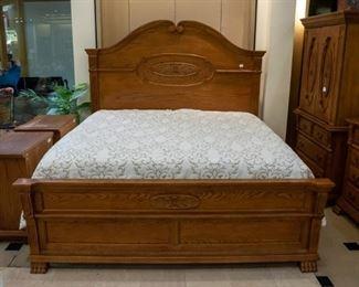 King bed, mattress and box springs.