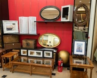 Lots of occasional tables, art, mirrors, and wooden boxes.  On the far left are three stack able tables.