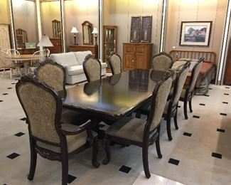 Formal dining table with 8 chairs and two leaves - 10' long with leaves.