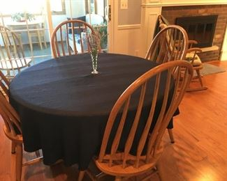 This is an vintage oak table with contemporary chairs.