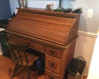 This is an authentic, solid-oak, roll-top desk -- a nice find!