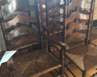 Set of 6 early 1900's ladderback chairs.  2 captains chairs and 4 chairs without arms.  Great condition for age.  Original seat.  Buy now $200 set