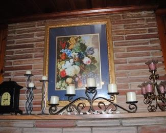 Ornate frame with picture and metal candleholders, mantel clock