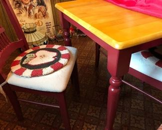 Wooden kitchen table with red legs; 4 red chairs